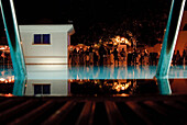 View over the water of a pool at night, Hammamet, Gouvernorat Nabeul, Tunisia, Africa