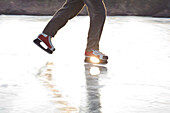 Ice skater on lake Ammersee, Upper Bavaria, Germany
