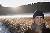 Senior man looking at camera, Windach, Upper Bavaria, Germany