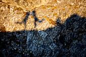 Shadow of two people on the rocks, Oberstdorf, Bavaria, Germany