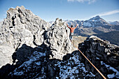 Man balancing on a rope, slackline in the mountains, Oberstdorf, Bavaria, Germany