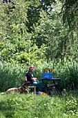 Farm worker resting, biological dynamic (bio-dynamic) farming, Demeter, Lower Saxony, Germany