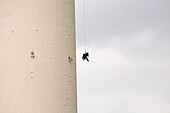 Two industrial climbers abseiling on the tower of Berlin's Television Tower, Alex, Berlin, Germany