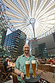 Café Sony Center, waiter with glasses of beer, Berlin, Germany