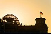 silhouette of German parliament, Reichstag dome at sunset, Berlin, Germany