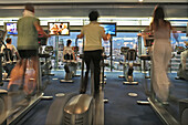 People exercising at the gym Skyclub at highrise building Neues Kranzler Eck, Berlin, Germany, Europe