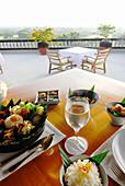Nasi Campur, indonese breakfast on the terrace of Amanusa Resort, Nusa Dua, Southern Bali, Indonesia, Asia