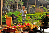 Breakfast in the sunlight with view at the garden, Rumah Bali hotel, Benoa, Southern Bali, Indonesia, Asia