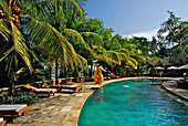 Pool under palm trees, Gajah Mina Beach Resort, South Bali, Indonesia, Asia