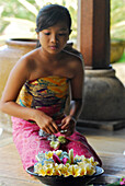 Girl with floral wreaths at the lobby of Four Seasons Resort, Jimbaran, Bali, Indonesia, Asia