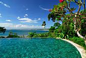 Pool under blue sky with seaview, Four Seasons Resort at Jimbaran, South Bali, Indonesia, Asia