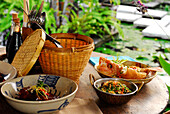 Asian food on a table at Restaurant Warung Mi, Four Seasons Resort at Jimbaran, South Bali, Indonesia, Asia