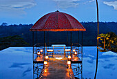 Water basin with pavilion on the roof of a restaurant in the evening, Kupu Kupu Barong Resort, Ubud, Indonesia, Asia