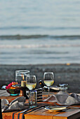 A table is laid at the beach in the evening, Restaurant of the Matahari Hotel, Pemuteran, North west Bali, Indonesien, Asia