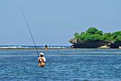 Fishermen angling in the lagoon, Nusa Dua, Bali, Indonesia, Asia