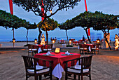 Tables are laid at the beach, restaurant of the La Taverna Hotel, Sanur, South Bali, Indonesia, Asia