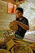 A basket maker at work, Tenganan, Bali Aga village, East Bali, Indonesia, Asia