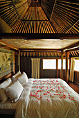 Bed covered with petals at a bungalow of the Amandari Resort, Yeh Agung valley, Bali, Indonesia, Asia