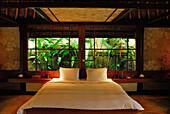 Bed at a bungalow of the Amandari Resort, Yeh Agung valley, Bali, Indonesia, Asia