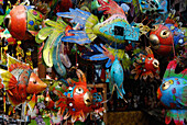 Colourful fishes made of tin at a market stand, Ubud, Central Bali, Indonesia, Asia