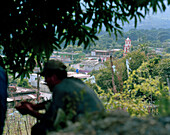 A farm worker resting, Actopan village in the background, Veracruz province, Mexico, America