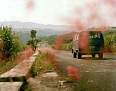 Van driving on a country road, Veracruz province, Mexico, America