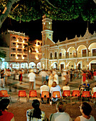 People dancing on the Zocalo in front of the town hall Palacio Municipal at the Old Town in the evening, Veracruz, Veracruz province, Mexico, America