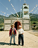 Two local men in front of the unfinished church at the village Jalcomulco, Puebla province, Mexico, America