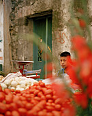Boy at a market stand with vegetables and flowers at the village San Nicholas los Ranchos, Puebla province, Mexico, America