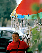 Street vendor with paper-mâché skeletons, Centro Historico, Coyoacan, Mexico City, Mexico, America
