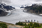 Tourists View Salmon Glacier Stewart British Columbia BC Canada near Hyder Alaska AK US United States travel vacation tour tourism sightseeing