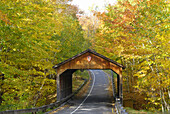 Wooden covered bridge on the Pierce Stockling Scenic Drive during Autumn fall color foliage in the Sleeping Bear Dunes National Park along the shores of Lake Michigan on Michigan s western shore