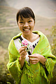 Adult, Adults, Asia, Asian, Asians, China, Color, Colour, Daytime, Ethnic, Ethnicity, Exterior, Facial expression, Facial expressions, Facing camera, Female, Flower, Flowers, Grin, Grinning, Guangxi, Happiness, Happy, Hold, Holding, Human, Joy, Kwangsi, L