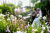 Bridal bouquet, Bridal bouquets, Bride, Bridegroom, Bridegrooms, Brides, Color, Colour, Contemporary, Couple, Couples, Cuddle, Cuddles, Cuddling, Daisies, Daisy, Daytime, Dress, Dresses, Embrace, Embracing, Exterior, Flower, Flowers, Garden, Gardens, Groo