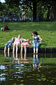 Young girls cooling off on a hot summer's day in Leiden, The Netherlands.