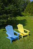 Adirondack chairs in the back garden of a home in Castine, Penobscot Bay, Maine USA