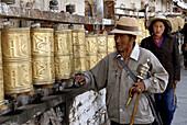 Tibetan pilgrim going round the Potala to end the pilgrimage. Lhasa. Tibet. China.