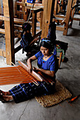 Woman using loom, San Antonio Palopo. Guatemala