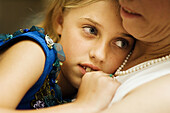 Closeup, Color, Colour, Contemporary, Cuddle, Cuddled, Cuddling, Daughter, Daughters, Dress, Dressed