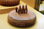 Greek pottery: pyxis with three terracotta horses-shaped handle in the Ancient Agora Museum (Stoa of Attalos), Athens. Greece