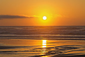 Setting Sun over the Pacific Ocean - Pacific City, Oregon