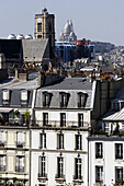 The view of Pompidou Centre and Sacre-Coeur Church from the rooftop of Paris. France