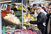 Fruits stall in weekend food market. Paris. France