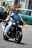 A young couple on a motorcycle. Naple. Campania. Italy