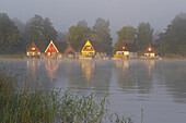 Holiday homes at lake Mirow in early morning fog, Mecklenburg Lake District, Mecklenburg-Western Pomerania, Germany
