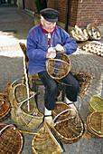 Basket maker at Kiepenkerl-Sunday in Stadtlohn, Muensterland, North Rhine-Westphalia, Germany