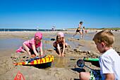 Children playing at beach, Norddorf, Amrum island, North Frisian Islands, Schleswig-Holstein, Germany