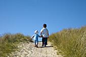 Children in dunes, Amrum island, North Frisian Islands, Schleswig-Holstein, Germany