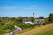 Thatched houses and lighthouse, Pellworm Island, North Frisian Islands, Schleswig-Holstein, Germany