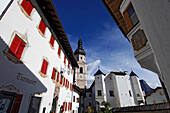 Church and parish hall in the sunlight, Kastelruth, South Tyrol, Italy, Europe